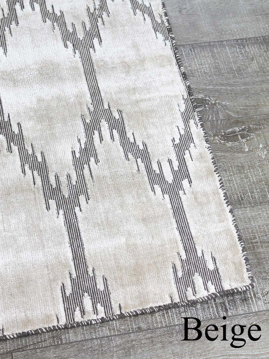 ikat beige stans rug centre hand woven wool and art-silk