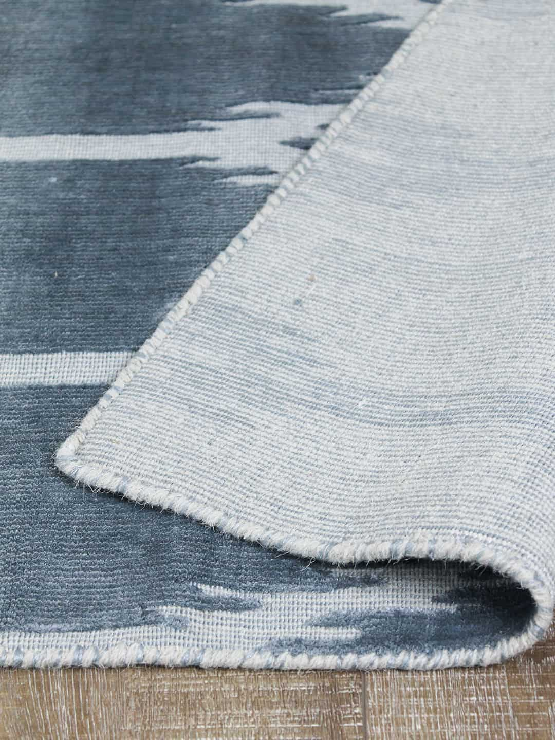 ikat blue stans rug centre hand woven wool and art-silk