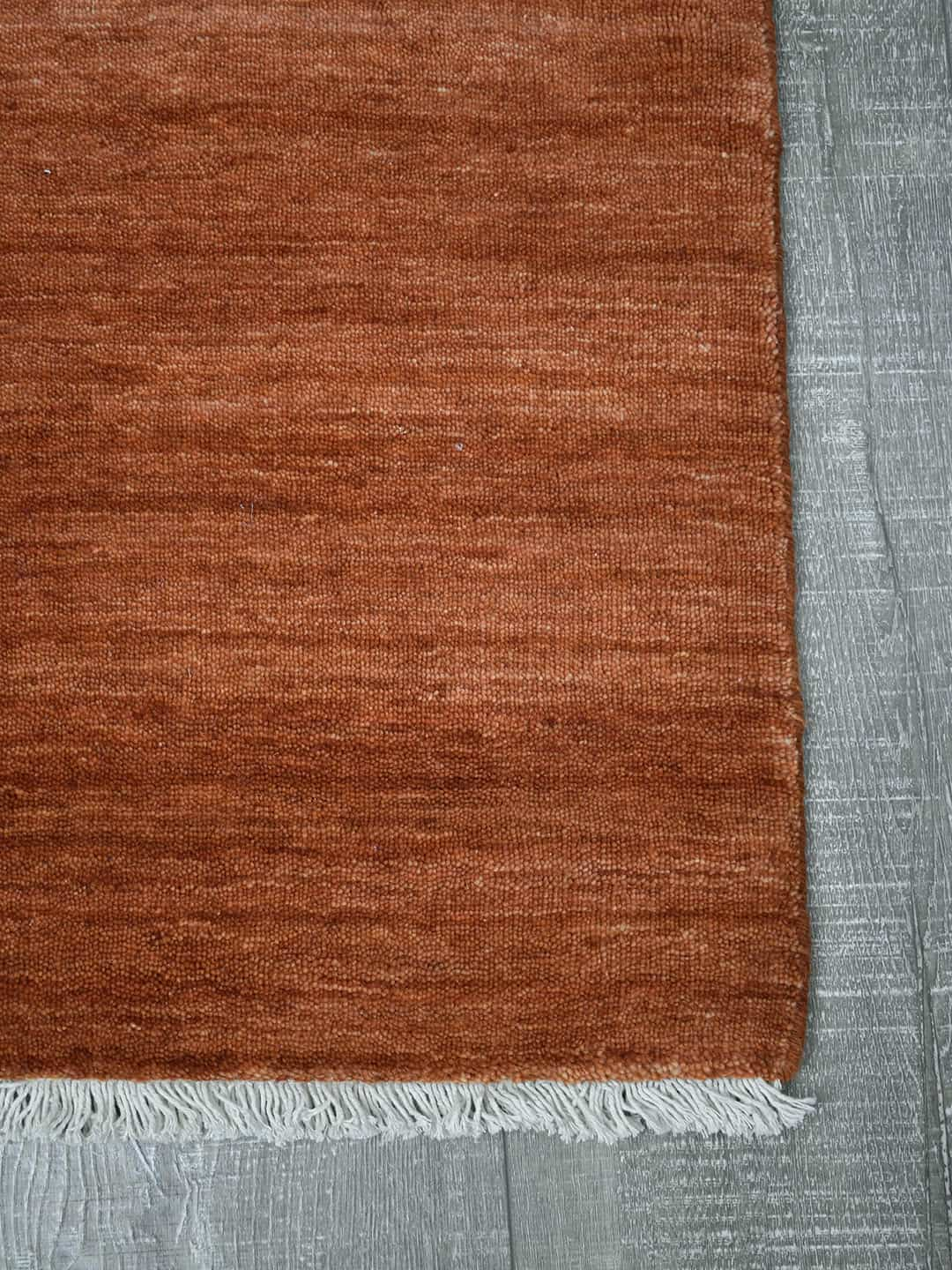 Diva-Ochre-orange-stans-rug-centre-hand loom knotted pure wool rug
